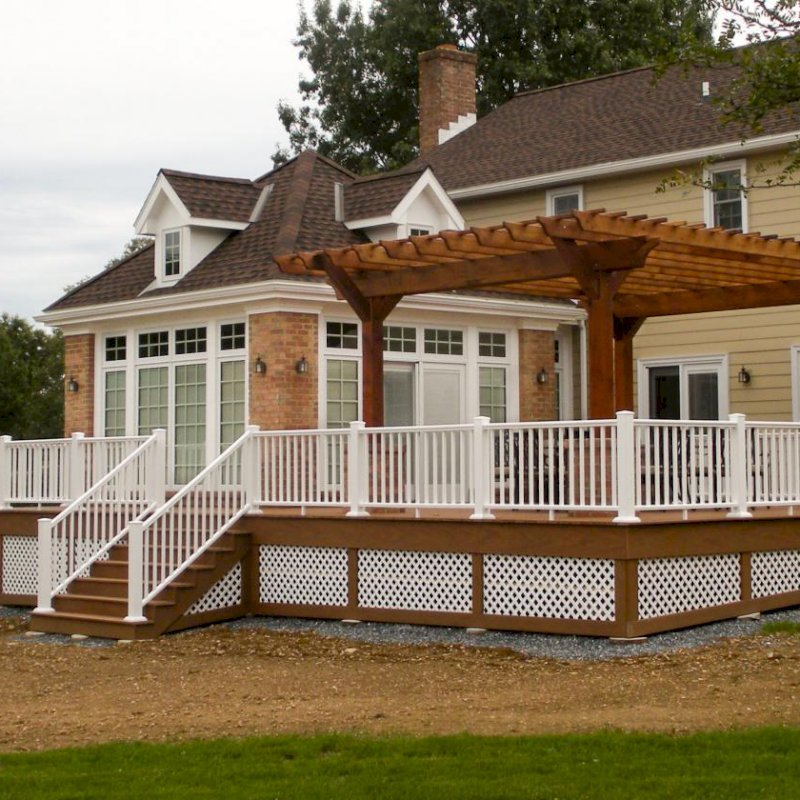 "The Traditional Wooden Garden Pergola (Options: 20' L x 15' W, Mature Redwood, No Electrical Wiring Trim, Slats at 12"" and Rafters at 18"", Widthwise Roof Support Timbers, 4-Post Anchor Kit for Wood, No Ceiling Fan Base, No Privacy Panels, No Curtain Rods, 9' Post Height, Transparent Premium Sealant). Photo Courtesy of Mr. Jeffrey S. of Lebanon, PA."