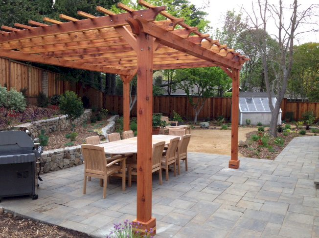 "The Traditional Wooden Garden Pergola (Options: 16' L x 14' W, California Redwood, No Electrical Wiring Trim, Open Roof with Slats at 12"", Rafters at 18"", Lengthwise Roof Support Timbers, 4-Post Anchor Kit for Stone, No Ceiling Fan Base, No Curtain Rods, No Privacy Panels, 9' Post Height, Transparent Premium Sealant). Photo Courtesy of Paul Remer of San Rafael, CA."