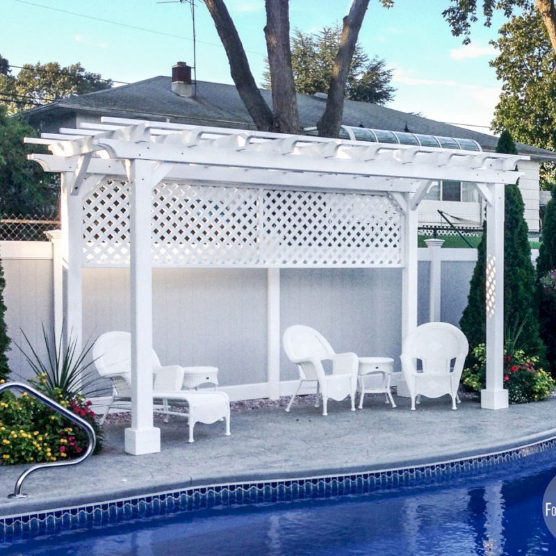 "The Traditional Wooden Garden Pergola (Options: 16' L x 8' W, Douglas-fir, No Electrical Wiring Trim, Open Roof with Slats at 12"", Rafters at 18"", Lengthwise Roof Support Timbers, 4-Post Anchor Kit for Stone, No Ceiling Fan Base, 1 Privacy Panel, No Curtain Rods, 9' Post Height, Off-White Oil-Based Primer). Photo Courtesy of Leo and Genevieve Kirchner of South Amboy, New Jersey."
