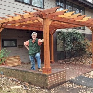 "The Traditional Wooden Garden Pergola (Options: 11' 4"" x 16', California Redwood, Slats at 36"", Custom Posts Length, 4-post kit for stone, brick, or concrete, Transparent Premium Sealant). Photo Courtesy of Jhon & Janet K. of Falls Church, Virginia."
