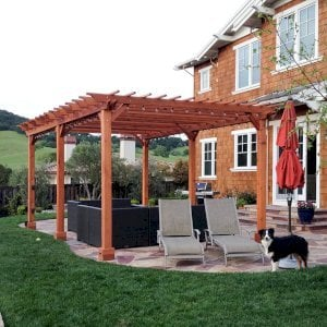 "The Traditional Wooden Garden Pergola (Options: 22' L x 14' W, Mature Redwood, Electrical Wiring Trim for 2 Posts, Open Roof with Slats at 6"", Rafters at 18"", Widthwise Roof Support Timbers, 6-Post Anchor Kit for Concrete, No Ceiling Fan Base, No Privacy Panels, No Curtain Rods, 9.5' Post Height, Transparent Premium Sealant). Photo Courtesy of Roger Cassidy of Novato, CA."