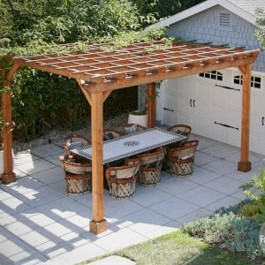 "The Traditional Wooden Garden Pergola (Options: 15' L x 12' W, Douglas-fir, Electrical Wiring Trim for 1 Post, Open Roof with Slats at 18"", Rafters at 18"", 4-Post Anchor Kit, 1 Ceiling Fan Base, No Privacy Panels, No Curtain Rods, 9' Post Height, Transparent Premium Sealant). Structure has been up for nearly 2 years when these photos were taken.Photo Courtesy of L. Martling of Los Angeles, CA."