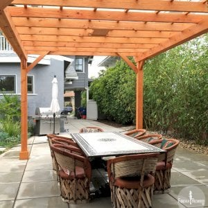 "The Traditional Wooden Garden Pergola (Options: 15' L x 12' W, Douglas-fir, Electrical Wiring Trim for 1 Post, Open Roof with Slats at 18"", Rafters at 18"", Lengthwise Roof Support Timbers, 6-Post Anchor Kit for Concrete, 1 Ceiling Fan Base, No Privacy Panels, No Curtain Rods, 9' Post Height, Transparent Premium Sealant). Photo Courtesy of L. Martling of Los Angeles, CA."