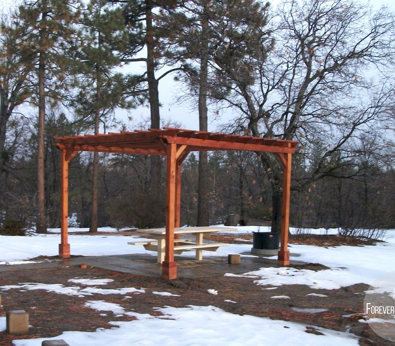 "The Traditional Wooden Garden Pergola (Options: 15' L x 15' W, Mature Redwood, No Electrical Wiring Trim, Open Roof with Slats at 18"", Rafters at 18"", 4-Post Anchor Kit for Stone, No Ceiling Fan Base, No Privacy Panels, No Curtain Rods, 9' Post Height, Transparent Premium Sealant). 1 of 9 Pergolas installed in the Cleveland National Forest's Burnt Rancheria Campground,1 hr west of San Diego."