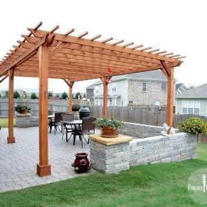 "The Traditional Wooden Garden Pergola (Options: 25' L x 16' W, Mature Redwood, No Electrical Wiring Trim, Slats at 12"" and Rafters at 18"", Lengthwise Roof Support Timbers, 6-Post Anchor Kit For Stone, No Ceiling Fan Base, No Privacy Panels, No Curtain Rods, 9' Post Height, Transparent Premium Sealant)."