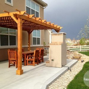 The Traditional Wooden Garden Pergola (Options: 20' L x 12' W, Mature Redwood, No Electrical Wiring Trim, Lattice Roof, Lengthwise Roof Support Timbers, 4-Post Anchor Kit for Stone, No Ceiling Fan Base, No Privacy Panels, No Curtain Rods, 9.5' Post Height, Transparent Premium Sealant).