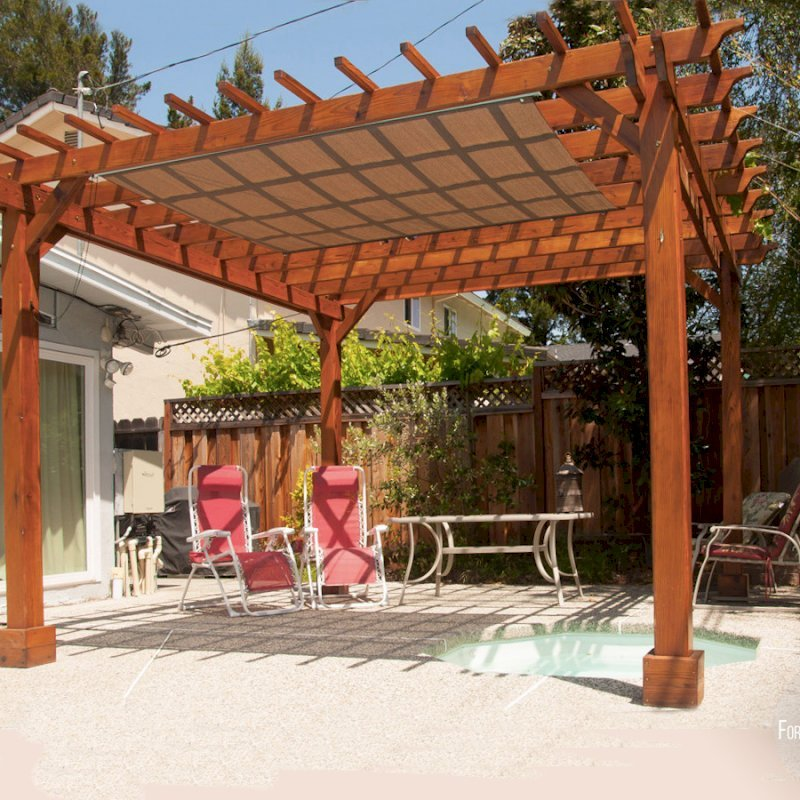 "The Traditional Wooden Garden Pergola (Options: 14' L x 14' W, California Redwood, No Electrical Wiring Trim, Open Roof with Slats at 12"", Rafters at 18"", 4-Post Anchor Kit for Stone, No Ceiling Fan Base, No Privacy Panels, No Curtain Rods, 9' Post Height, Transparent Premium Sealant). Shade cloth added by customer after installation."