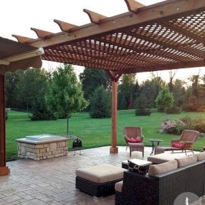 The Traditional Wooden Garden Pergola (Options: 20' L x 16' W, Mature Redwood, No Electrical Wiring Trim, Lattice Roof, Lengthwise Roof Support Timbers, 4-Post Kit for Stone, Brick, or Concrete, No Ceiling Fan Base, No Privacy Panels, No Curtain Rods, 10' Post Height, Transparent Premium Sealant). Photo Courtesy of David Wilson.
