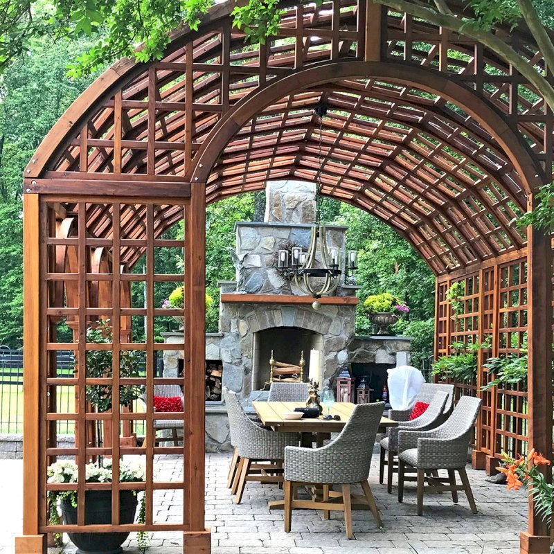 The Victorian Trellis (Options: 22' L x 14' W, Combination of Arcs and Lattice Panels, Mature Redwood, No Rain Guard, 9' Post Height, No Electrical Wiring Trim,  4-Post Anchor Kit for Stone, No Ceiling Fan Base, Transparent Premium Sealant). Photo Courtesy of JR and Trish West of King George, Virginia.
