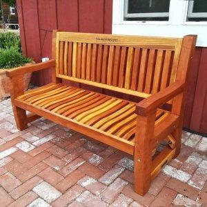 Ti Amo Bench (Options: 5 ft, Redwood, No Cushion, Custom Engraving, Transparent Premium Sealant). Photo Courtesy of R. Manley of Sonoma, Alabama.