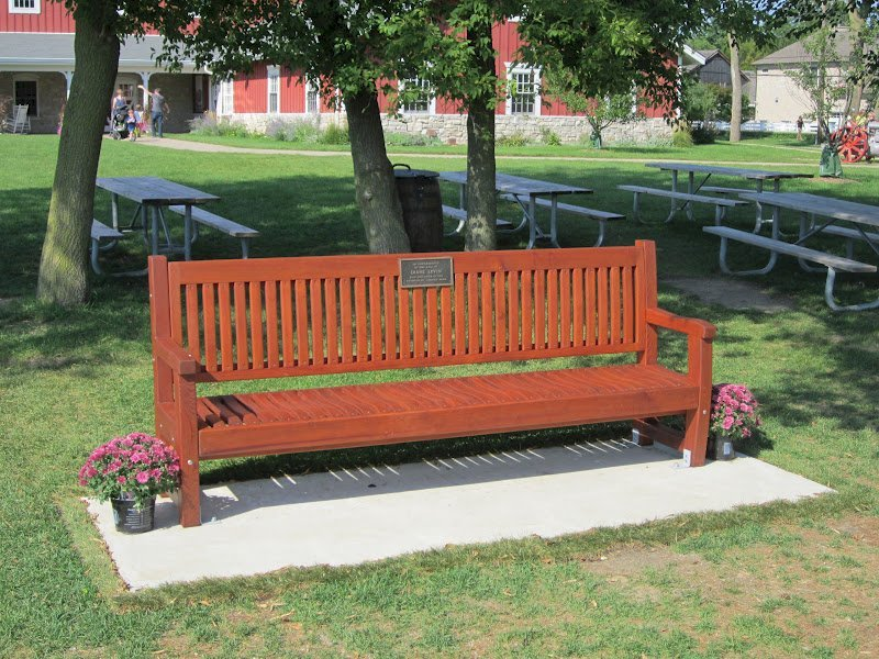 Ti Amo Bench (Options: 8 ft, Old-Growth Redwood, No Cushion, No Engraving, Custom Plaque Provided by Customer, Transparent Premium Sealant). Photo Courtesy of Todd Price of the Wagner Farm.