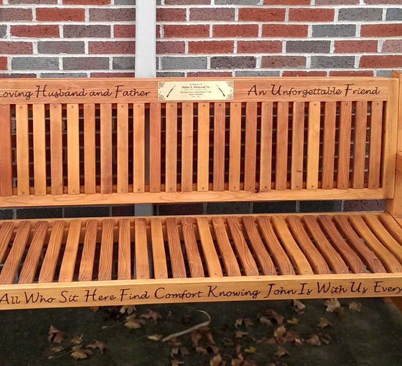 Ti Amo Bench (Options: 6 ft, Mature Redwood, No Cushion, Custom Engraving, Custom Plaque Provided by Customer, Transparent Premium Sealant). This customer photo shows how you can combine using our Engraving option with a Plaque that you can have made locally or via our Engraving partner in Santa Rosa, CA, Jay's Engraving.