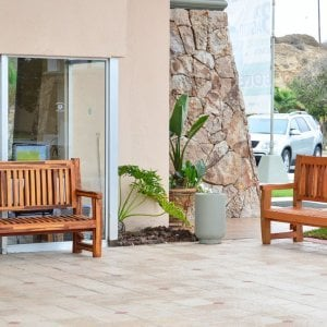 Ti Amo Benches (Options: 5 ft, Right-Redwood and Left-Mosaic Eco-Wood, No Cushion, No Engraving, Transparent Premium Sealant). Photo Courtesy of The Estero Beach Resort of Ensenada, Baja, Mexico.