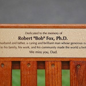 In Memory of Bob Fox. Ti Amo Bench (Options: 6 ft, Mature Redwood, No Cushion, No Engraving, Custom Plaque Provided by Customer, Transparent Premium Sealant). Photo Courtesy of Fox Family.
