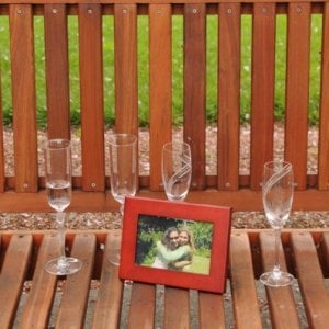 Ti Amo Bench (Options: 5 ft, Old-Growth Redwood, No Cushion, No Engraving, Custom Plaque Provided by Customer, Transparent Premium Sealant). Photo Courtesy of Ms. Linda L. of Napa, CA.
