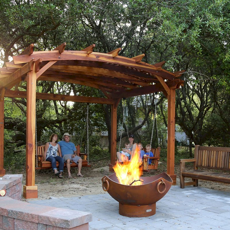 Ti Amo Bench (Options: 6 ft, Redwood, No Cushion, No Engraving, Transparent Premium Sealant). Photo Also Shows an Arched Pergola with Bench Swing Seats. Photo Courtesy of Tom Marten of Kitty Hawk, North Carolina.