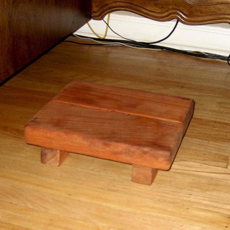 "Tiny Foot Stool (Options: Mature Redwood, 3 1/2 "" H, No Engraving, Transparent Premium Sealant). Photo Courtesy of Ms. Brenda Budyzlowsky."