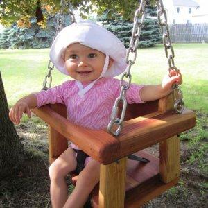 Toddler Swing Seat (Options: Mature Redwood, All Tree Hanging Hardware, Transparent Premium Sealant). Photo Courtesy of Jenny & Justin C. Lambertville, MI.