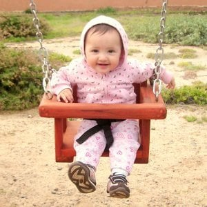 Toddler Swing Seat (Options: Mature Redwood, All Beam Hanging Hardware, Transparent Premium Sealant). 8 month old Norma Mia is having a blast on her swing!