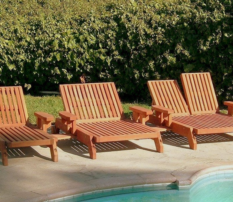 "Tony's Chaise Loungers (Options: L to R: Single, Honeymoon and Double, Standard 74"", Mature Redwood, Single has Snack Tray on Right Side, Honeymoon and Double have Snack Trays on Both Sides, 13"" H, Wheels, No Cushion, Transparent Premium Sealant)"