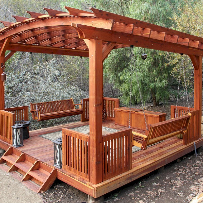 Traditional Storage Bench (Options: 79 1/2 L x 24 W x 24 H inches, Redwood, Split Seat, Add Pistons, No Engraving, Transparent Premium Sealant). Photo Also Shows a Bench Swing Seat Attached to an Arched Pergola with Deck and Custom Rails. Photo Courtesy of Bob P. of Westlake Village, CA.
