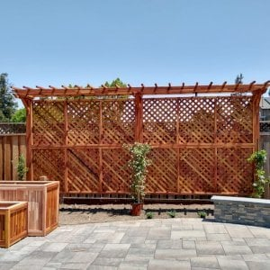 "Two-Post Arbors (Options: 20' x 2'-6"", Mosaic Reclaim Wood, With Lattice Privacy Panels, 12 ft Posts Height, 3-Oversize Anchor Kits, Transparent Premium Sealant). Photo Courtesy of M. Delligatti of San Jose, CA."