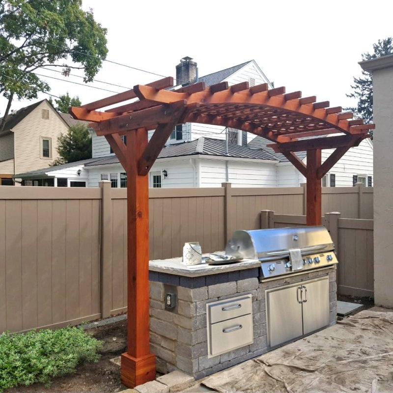 """Custom Arbor (Opstions: 4' x 12', Redwood, 6"""" x 6"""" Posts and 2"""" x 6"""" Roof Timbers, Arched Rafters by Custom Request, Transparent Premium Sealant). Photo Courtesy of J. Lyons of Columbus, CA."""