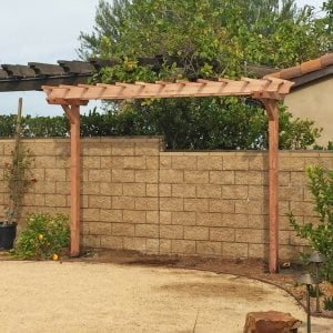 Two-Post Arbor (Options: 12' x 3', Redwood, No Privacy Panel, 10 ft Posts Height, 2-Post Embedded in Concrete, Unfinished). Photo Courtesy of Joseph Zappala of Newport Coast, CA.