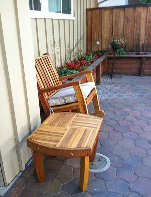 """Vera's Side Table (Options: 21 ½"""", Redwood, 18"""" H, Transparent Premium Sealant) with a Ruth Rocking Chair. Photo Courtesy of Julie Joyce of Cupertino, CA."""