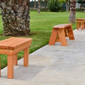 Wood Patio Bench (Options: 3 1/2 ft x 14 1/4 inches W x 18 1/2 inches H, Douglas-fir, No Cushion, No Engraving, Cherry Stain Premium Sealant). Photo also shows some round picnic benches.