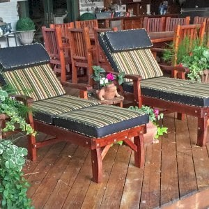 """Pool Loungers (Options: Single, Standard 74"""", Mature Redwood, 13"""" H, Include Wooden Wheels, Transparent Premium Sealant). A San Francisco Patio Table Set in Background. Photo Courtesy of Charles Fronheiser."""