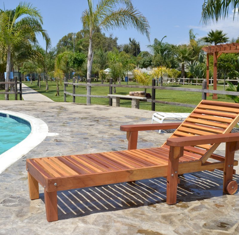 """Pool Lounger (Options: Single, Standard 74"""", Redwood, 13"""" H, Include Wooden Wheels, Transparent Premium Sealant). La grange style armrests & 54"""" L bed by custom request. Photo also shows The Fan Pergola in the background."""