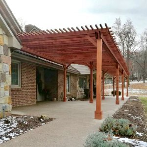 "Garden Pergolas (Options: 22' L x 14.5' W & 42' L x 8' W [Connected], Mature Redwood, No Electrical Wiring Trim, Open Roof with Slats at 18"", Rafters at 18"", Lengthwise Roof Support Timbers, 9-Post Anchor Kit for Stone, No Ceiling Fan Base, No Privacy Panels, No Curtain Rods, 9.5' Post Height, Transparent Premium Sealant). Photo Courtesy of K. Feliciani of Greensburg, Pennsylvania."