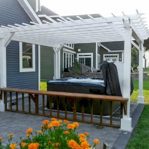 """Garden Pergola (Options: 16' L x 14' W, Douglas-fir, No Electrical Wiring Trim, Open Roof with Slats at 12"""", Rafters at 18"""", 4-Post Anchor Kit for Concrete, No Ceiling Fan Base, No Privacy Panels, No Curtain Rods, 9' Post Height, Off-White Oil-Based Primer). Photo Courtesy of V. Yzaguirre of Lewes, Delaware."""