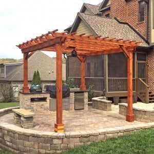 "Garden Pergola (Options: 14' L x 12' W, Redwood, Electrical Wiring Trim for 2 Posts, Open Roof with Slats at 12"", Rafters at 18"", 4-Post Anchor Kit, 1 Ceiling Fan Base, No Privacy Panels, No Curtain Rods, Transparent Premium Sealant). Photo Courtesy of T. Wade of Clinton, TN."