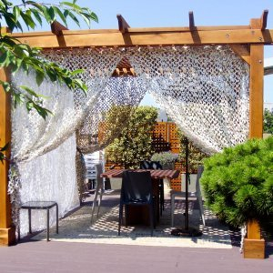 Add some fabric for a special touch. Garden Pergola (Options: 10' L x 10' W, Mature Redwood, No Electrical Wiring Trim, Lattice Roof, 4-Post Anchor Kit for Stone, No Ceiling Fan Base, No Privacy Panels, No Curtain Rods, 9' Post Height, Transparent Premium Sealant).