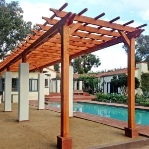 "Garden Pergola (Options: 40' L x 9' W, Douglas-fir, No Electrical Wiring Trim, Open Roof with Slats at 18"", Rafters at 18"", Lengthwise Roof Support, 8-Post Anchor Kit for Stone, No Ceiling Fan Base, No Privacy Panels, No Curtain Rods, 9.5' Post Height, Transparent Premium Sealant). Photo Courtesy of Emilio E. of Malibu, CA."