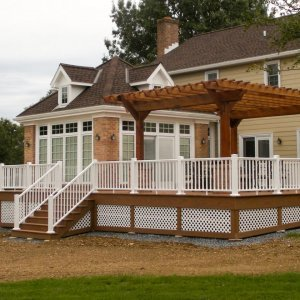 "Garden Pergola (Options: 20' L x 15' W, Mature Redwood, No Electrical Wiring Trim, Slats at 12"" and Rafters at 18"", Widthwise Roof Support Timbers, 4-Post Anchor Kit for Wood, No Ceiling Fan Base, No Privacy Panels, No Curtain Rods, 9' Post Height, Transparent Premium Sealant). Photo Courtesy of Mr. Jeffrey S. of Lebanon, PA."