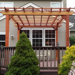 "Garden Pergola (Options: 15' L x 12' W, Redwood, No Electrical Wiring Trim, Open Roof with Slats at 18"", Rafters at 18"", Widthwise Roof Support Timbers, 4- Post Anchor Kit for Wood, No ceiling Fan Base, No Privacy Panels, No Curtain Rods, 9' Post Height, Transparent Premium Sealant). Photo Courtesy of Ian Clarke of Allentown, NJ."