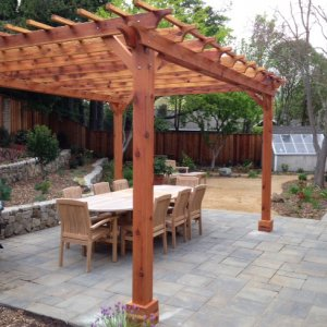 "Garden Pergola (Options: 16' L x 14' W, Redwood, No Electrical Wiring Trim, Open Roof with Slats at 12"", Rafters at 18"", Lengthwise Roof Support Timbers, 4-Post Anchor Kit for Stone, No Ceiling Fan Base, No Curtain Rods, No Privacy Panels, 9' Post Height, Transparent Premium Sealant). Photo Courtesy of Paul Remer of San Rafael, CA."