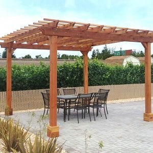 "Garden Pergola (Options: 14' L x 14' W, Redwood, Electrical Wiring Trim for 1 Post, Open Roof with Slats at 12"", Rafters at 18"", 4-Post Anchor Kit for Concrete, No Ceiling Fan Base, No Privacy Panels, No Curtain Rods, Transparent Premium Sealant). Photo Courtesy of J. Welsh of Los Gatos, CA."
