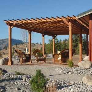 "Garden Pergola (Options: 30' L x 16' W, Mature Redwood, No Electrica Wiring Trim Kit, Slats at 12"" and Rafters at 18"", Lengthwise Roof Support Timbers, 6-Post Anchor Kit for Concrete, No Ceiling Fan Base, No Privacy Panels, No Curtain Rods, 9' Post Height, Transparent Premium Sealant, Custom: 2 extra post). Photo Courtesy of Mr. Craig Lawrence of Renton, WA."