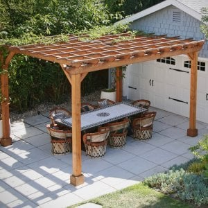 "Garden Pergola (Options: 15' L x 12' W, Douglas-fir, Electrical Wiring Trim for 1 Post, Open Roof with Slats at 18"", Rafters at 18"", 4-Post Anchor Kit, 1 Ceiling Fan Base, No Privacy Panels, No Curtain Rods, 9' Post Height, Transparent Premium Sealant). Structure has been up for nearly 2 years when these photos were taken.Photo Courtesy of L. Martling of Los Angeles, CA."