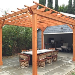 "Garden Pergola (Options: 15' L x 12' W, Douglas-fir, Electrical Wiring Trim for 1 Post, Open Roof with Slats at 18"", Rafters at 18"", Lengthwise Roof Support Timbers, 6-Post Anchor Kit for Concrete, 1 Ceiling Fan Base, No Privacy Panels, No Curtain Rods, Custom 45 Degree End Cuts for Rafters and Support Timbers, 9' Post Height, Transparent Premium Sealant). Photo Courtesy of L. Martling of Los Angeles, CA."
