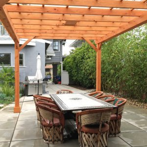 "Garden Pergola (Options: 15' L x 12' W, Douglas-fir, Electrical Wiring Trim for 1 Post, Open Roof with Slats at 18"", Rafters at 18"", Lengthwise Roof Support Timbers, 6-Post Anchor Kit for Concrete, 1 Ceiling Fan Base, No Privacy Panels, No Curtain Rods, 9' Post Height, Transparent Premium Sealant). Photo Courtesy of L. Martling of Los Angeles, CA."
