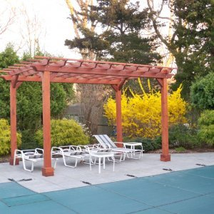 "Garden Pergola (Options: 16' L x 10' W, Mature Redwood, No Electrical Wiring Trim, Open Roof with Slats at 6"", Rafters at 18"", Lengthwise Roof Support Timbers, 4-Post Anchor Kit for Stone, No Ceiling Fan Base, No Privacy Panels, No Curtain Rods, 9' Post Height, Transparent Premium Sealant)."