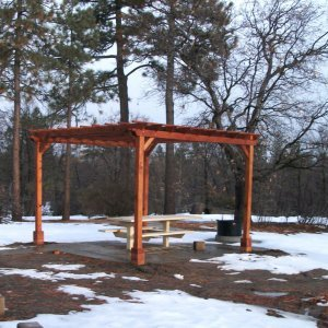 "Garden Pergola (Options: 15' L x 15' W, Mature Redwood, No Electrical Wiring Trim, Open Roof with Slats at 18"", Rafters at 18"", 4-Post Anchor Kit for Stone, No Ceiling Fan Base, No Privacy Panels, No Curtain Rods, 9' Post Height, Transparent Premium Sealant). 1 of 9 Pergolas installed in the Cleveland National Forest's Burnt Rancheria Campground,1 hr west of San Diego."