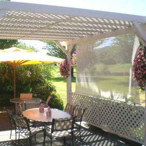 Garden Pergola (Options:14' x 16', Douglas-fir, No Electrical Wiring Trim, Lattice Roof, Lengthwise Roof Support, 4-Post Anchor Kit for Stone, No Ceiling Fan Base, 1 Privacy Panel, No Curtain Rods, 9' Post Height, Off-White Oil-Based Primer). Custom sail clothe made with Sunbrella fabric. Custom request: no roof slats included.