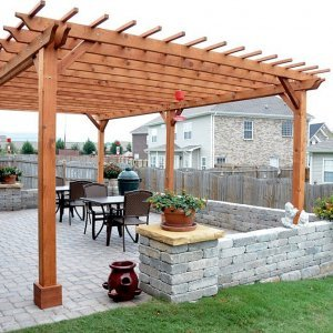 "Garden Pergola (Options: 25' L x 16' W, Mature Redwood, No Electrical Wiring Trim, Slats at 12"" and Rafters at 18"", Lengthwise Roof Support Timbers, 6-Post Anchor Kit For Stone, No Ceiling Fan Base, No Privacy Panels, No Curtain Rods, 9' Post Height, Transparent Premium Sealant)."