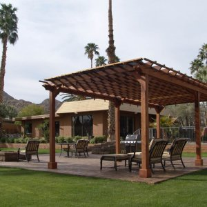 "Garden Pergola (Options: 26' L x 14' W, Mature Redwood, No Electrical Wiring Trim, Open Roof with Slats at 12"", Rafters at 18"", Lengthwise Roof Support Timbers, 6-Post Anchor Kit for Stone, No Ceiling Fan Base, No Privacy Panels, No Curtain Rods, 9' Post Height, Transparent Premium Sealant). Shade Cloth Added by Customer After Installation. Photo Courtesy of Val Kay of Indian Wells, CA."
